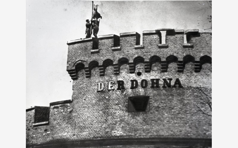 "On 10 April 1945, soldiers of the Soviet Army hoisted the banner of Victory on the ""Dohna"" tower. 1945. The photograph was granted by the State Archive of Kaliningrad Regiona"